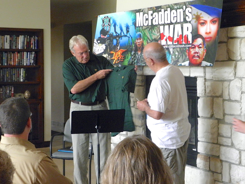 Guest Speaker, former Navy Seal Al Horner, presenting Craig with a Navy Seals shirt  to commemorate his third book release.